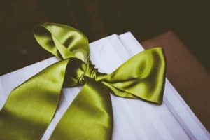 Green ribbon wrapped gift